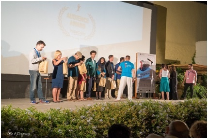 All the attending delegates on stage receiving a gift of local ingredients from Crete, courtersy of the festival and its sponsors. Photo Credit: Pantelis Sakkadakis