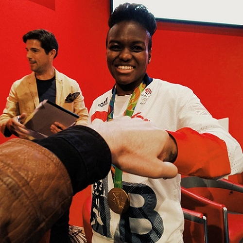 Fist bump with double Olympic gold medallist Nicola Adams photobombed by the guy from the Everest double glazing adverts.